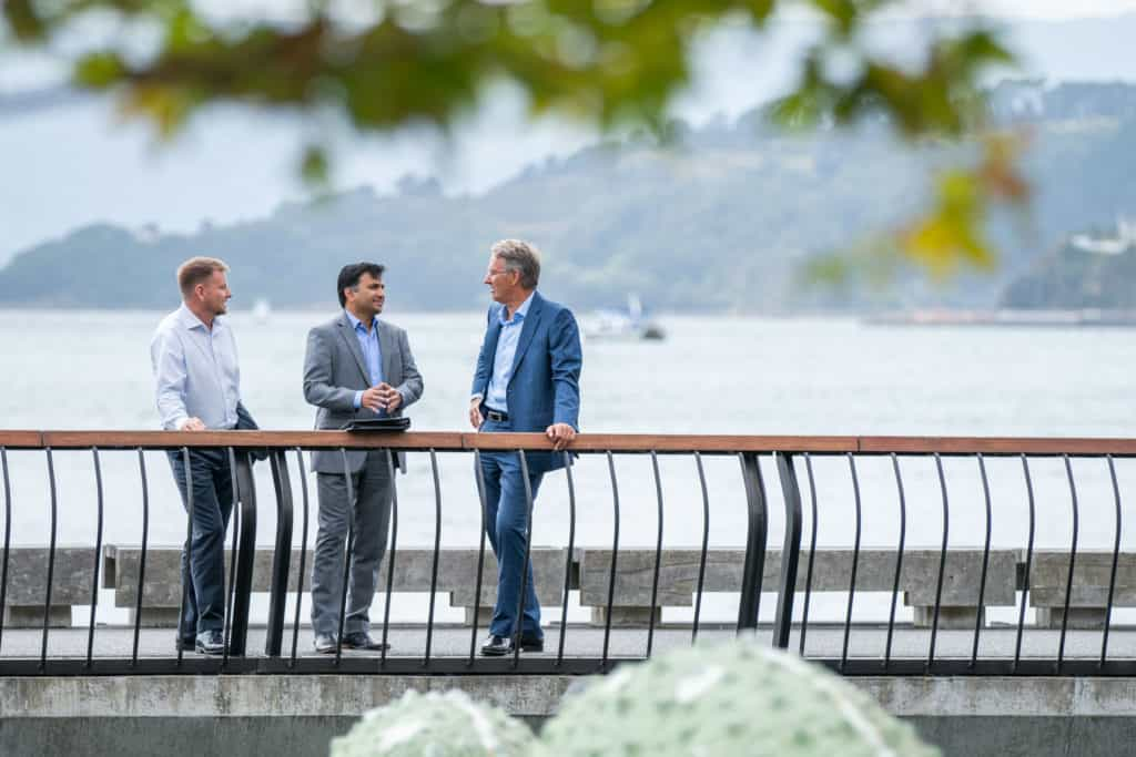Guy, Vishnu and Grant pause to talk on Wellington waterfront after a client meeting